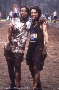 Two students covered in mud after an oozeball game.
