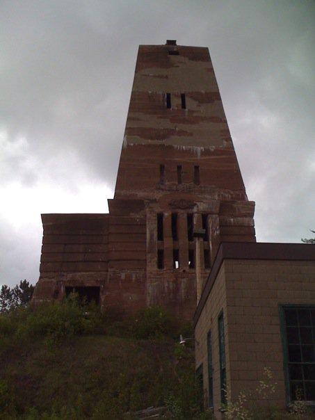 Attendees at the meeting had a wonderful guided tour of the buildings and exhibits operated by the Cliffs Shaft mining museum. The Cliffs company built two reinforced concrete shafthouses early in the Twentieth century. They have a unusual Egyptian obelisk architecture.