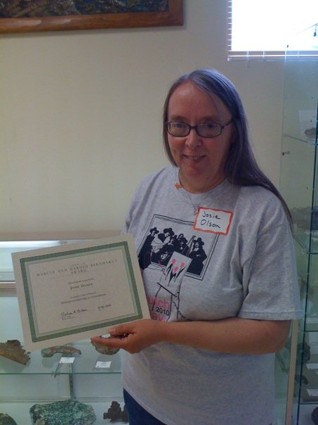 "Joanne ""Josie"" Olson was selected for the Harold and Marcia Betnhardt Award, given by the Northland Historical Consortium for her work in the local heritage community. Josie is active with a number of initiatives and groups, particularly the Ontonagon County Historical Society and the Rockland Historical Society."