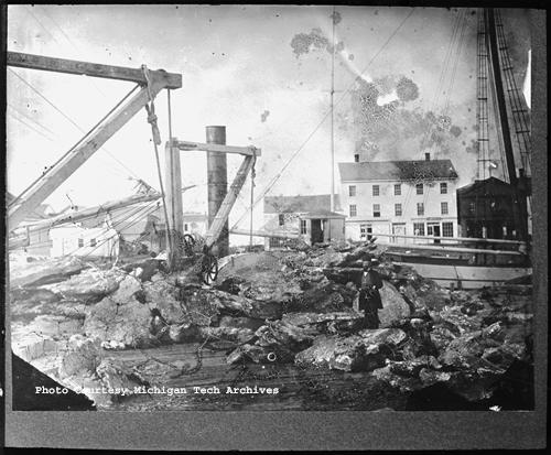 Pieces of mass copper awaiting shipment from the dock at Ontonagon. J.T. Reeder photo, Image MS042-048-999-U644.
