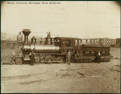 Some railroad employees pose with Mineral Range Railroad Engine #4. (Photo available on the Keweenaw Digital Archives)