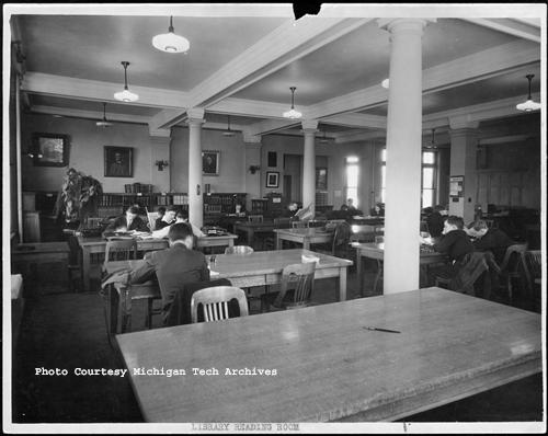 Students reading and researching in the Michigan College of Mines Library Reading Room, circa 1920s.