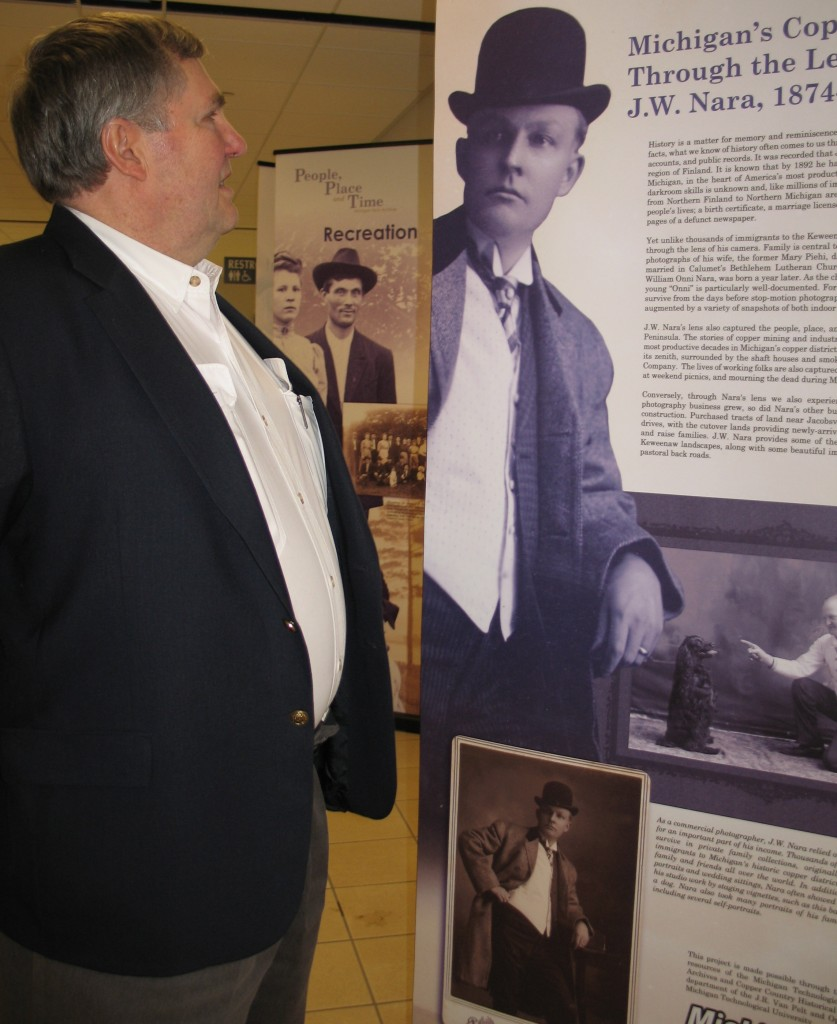 "Dr. Robert Nara viewing the ""People, Place and Time"" exhibit during its grand unveiling in December of 2009."