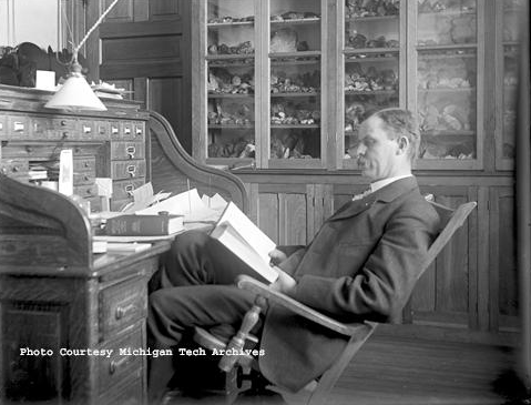 Arthur Edmund Seaman, former head of the Department of Geology and Mineralogy at the Michigan College of Mines (now Michigan Tech), conducting some research, circa 1905. Photograph is courtesy of the Keweenaw Digital Archives.
