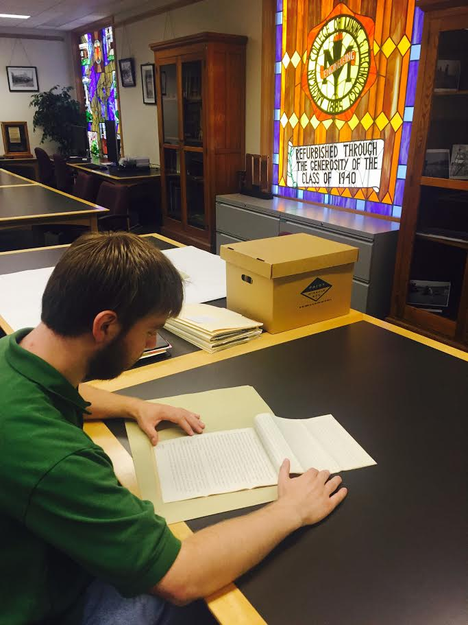 Our Friends of the Michigan Tech Library intern, Ryan Welle, has been a great asset during our busy summer season. Here is Ryan conducting some research into university reports from the 1890s to fulfill an important research request.