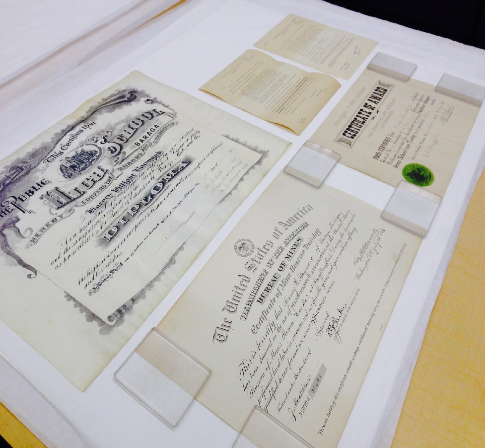 Documents from a family papers collection being rehumidified at the Michigan Tech Archives, 2015.