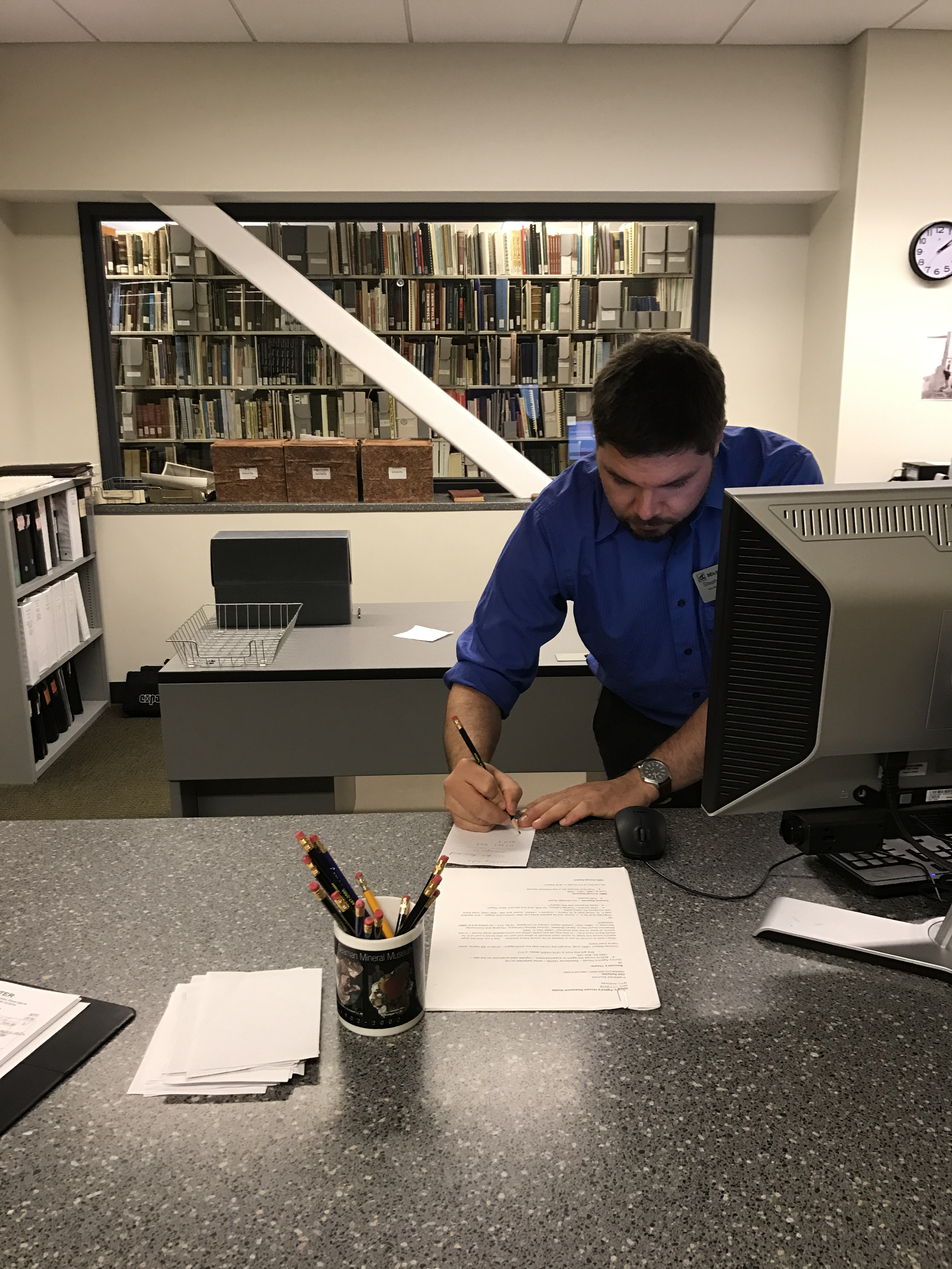 Steve Is Hard At Work Assisting A Patron With Some Genealogical Research