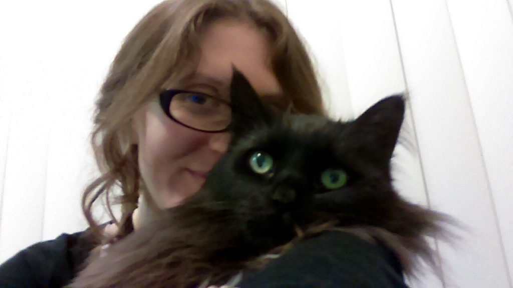 Allyse and her cat, Mr. Basil.