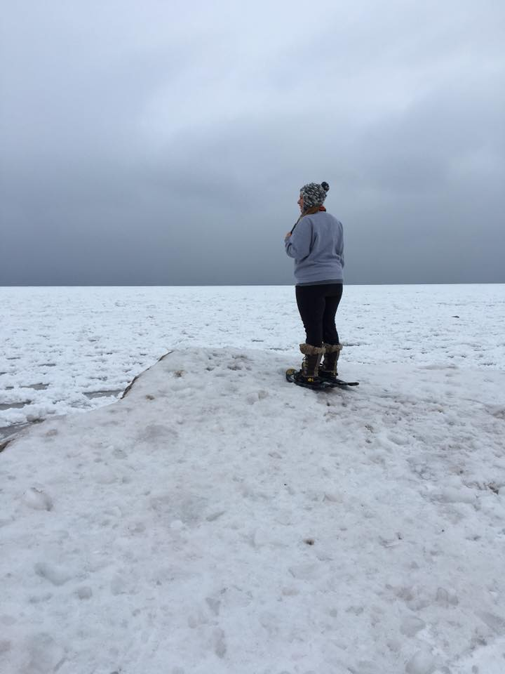 Georgeann snowshoeing at the shores of Lake Superior, McLain State Park.