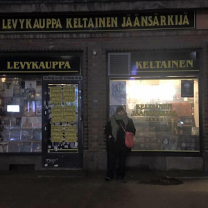 Treating myself after presenting at the International Oral History symposium. Standing in front of Levykauppa Keltainen Jäänsärkijä, a record store in Helsinki, Finland.