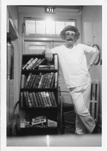 A masked person at the Copper Country Sanatorium takes the bookshelf for a spin.