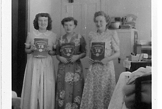 "Women residing at the Copper Country Sanatorium pose with the reminder that ""You can beat TB!"""