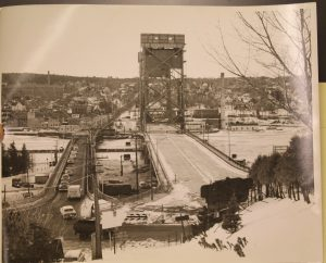 The photo above is a 1960 view from Hancock of the old and current bridges from the John T. Reeder Collection, Michigan Technological University and Copper Country Archives.