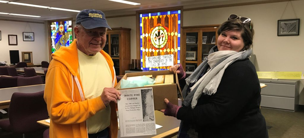 Roger Hewlett delivers the White Pine Copper Company slide collection to university archivist, Lindsay Hiltunen in May 2018.