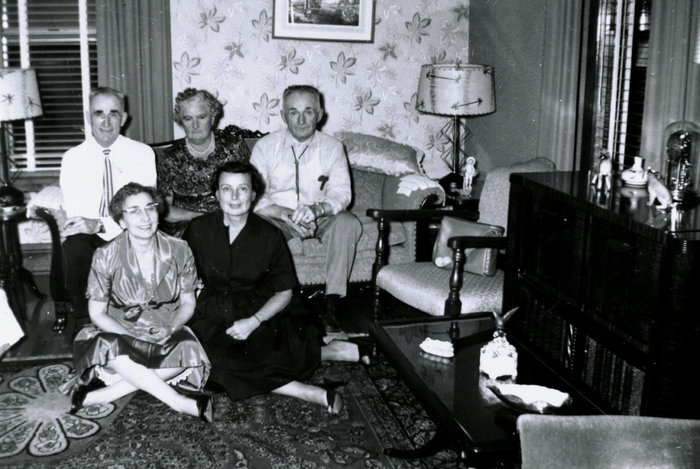 Five middle-aged relatives on a sofa