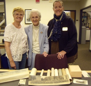 Former archivist, Beth Russell poses with the Raymond family, who donated a collection to Michigan Tech in 2014.