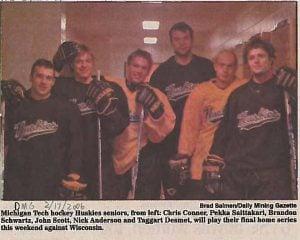 John Scott with teammates