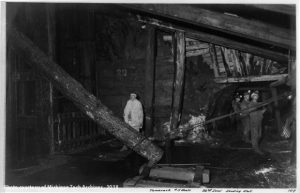 Image of men in timbered mine shaft