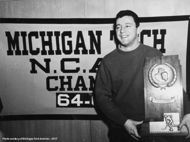 Tony Esposito with the NCAA Trophy