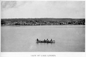 Canoe passing by Lake Linden