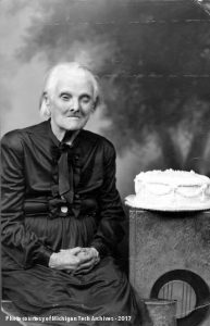 Elderly woman with birthday cake