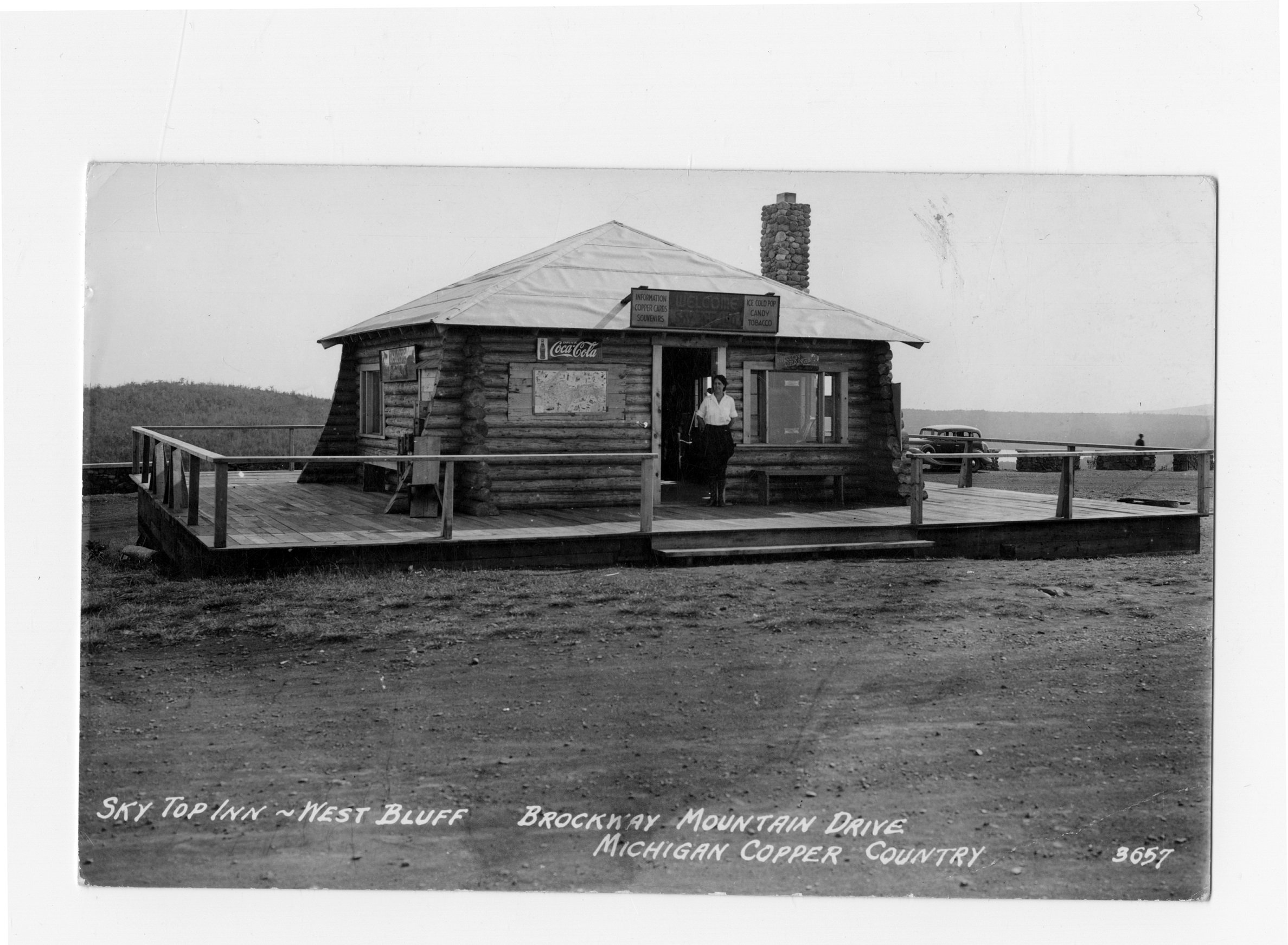 Image of log cabin building with many signs