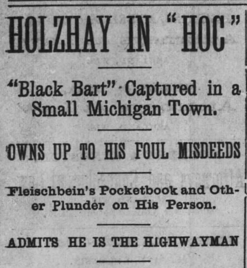 "Image of newspaper headline: ""HOLZHAY IN 'HOC'"""
