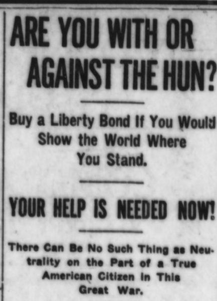 "Newspaper with headline: ""ARE YOU WITH OR AGAINST THE HUN?"""