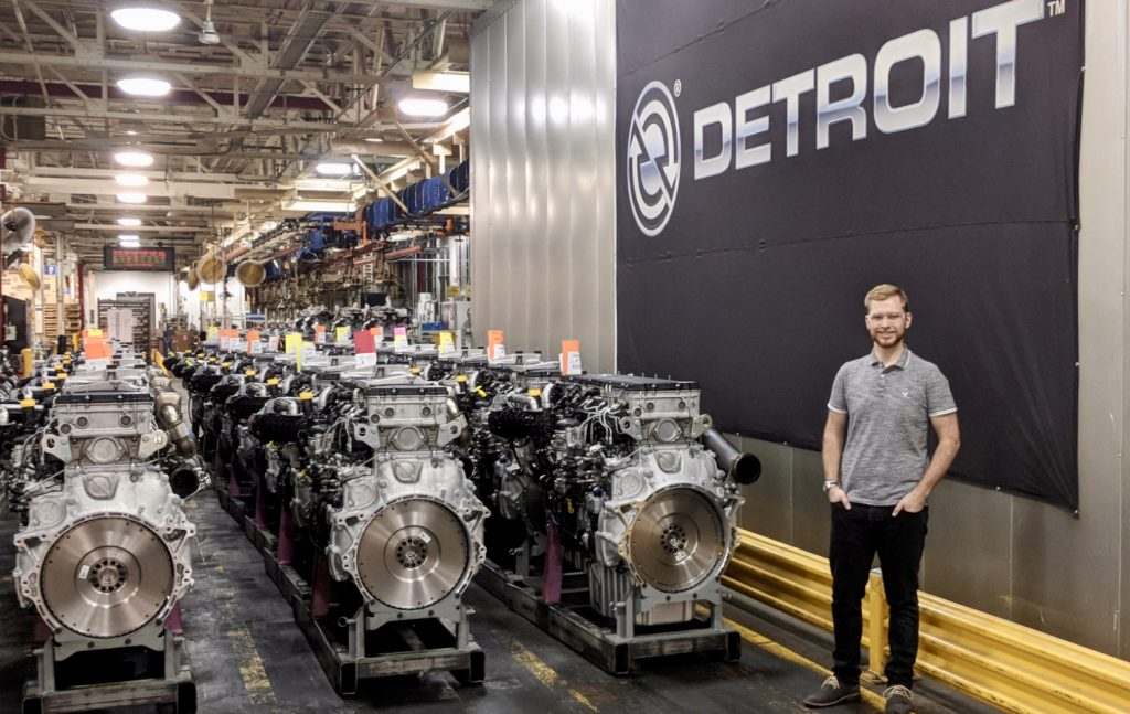 Student Tim Bart poses at Detroit Diesel where he is doing a summer internship