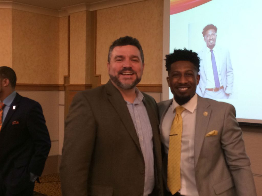 Donzell Dixson poses with Dean Johnson, dean of the Michigan Tech School of Business