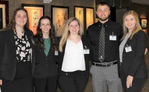 A group of five Michigan Tech students pose at competition.