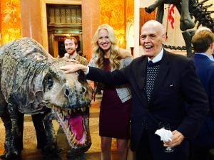 Amanda and Stan pose with a dinosaur at National History Museum