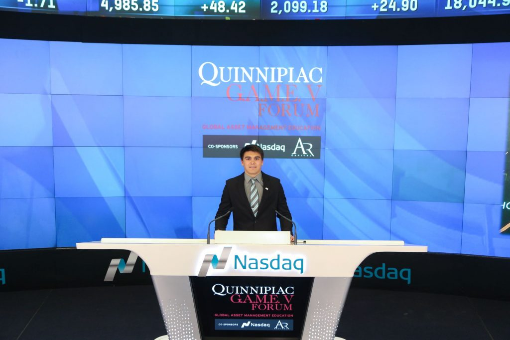 Student stands at Nasdaq
