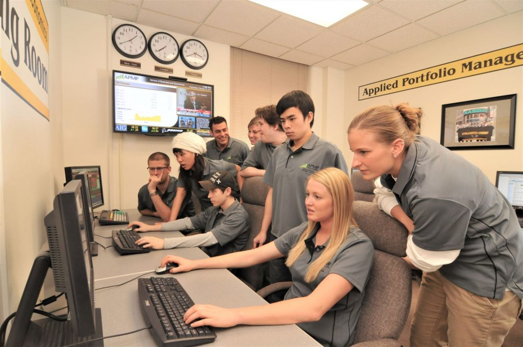 Students gather around computer