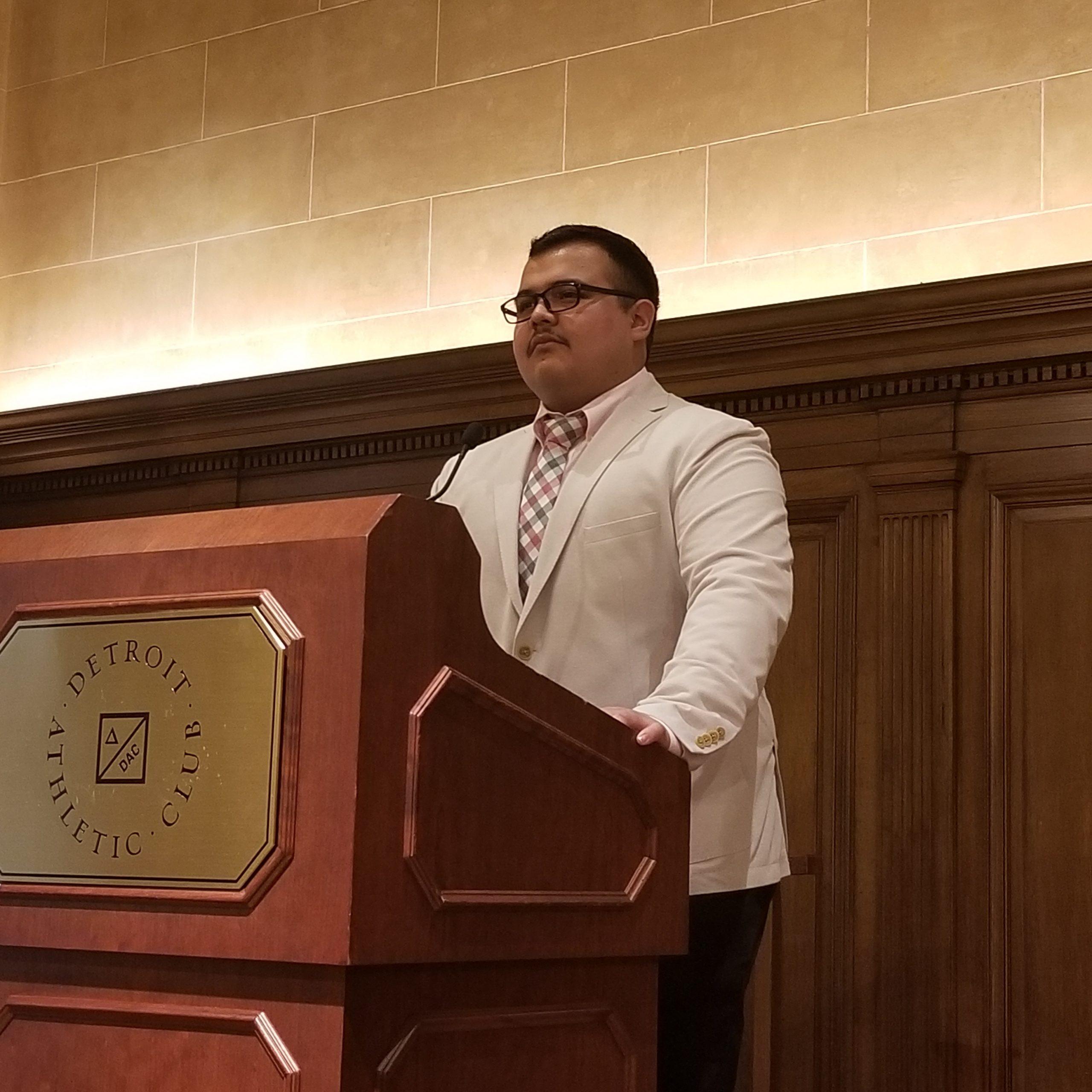 MTU student Marco Marquez stands at a podium