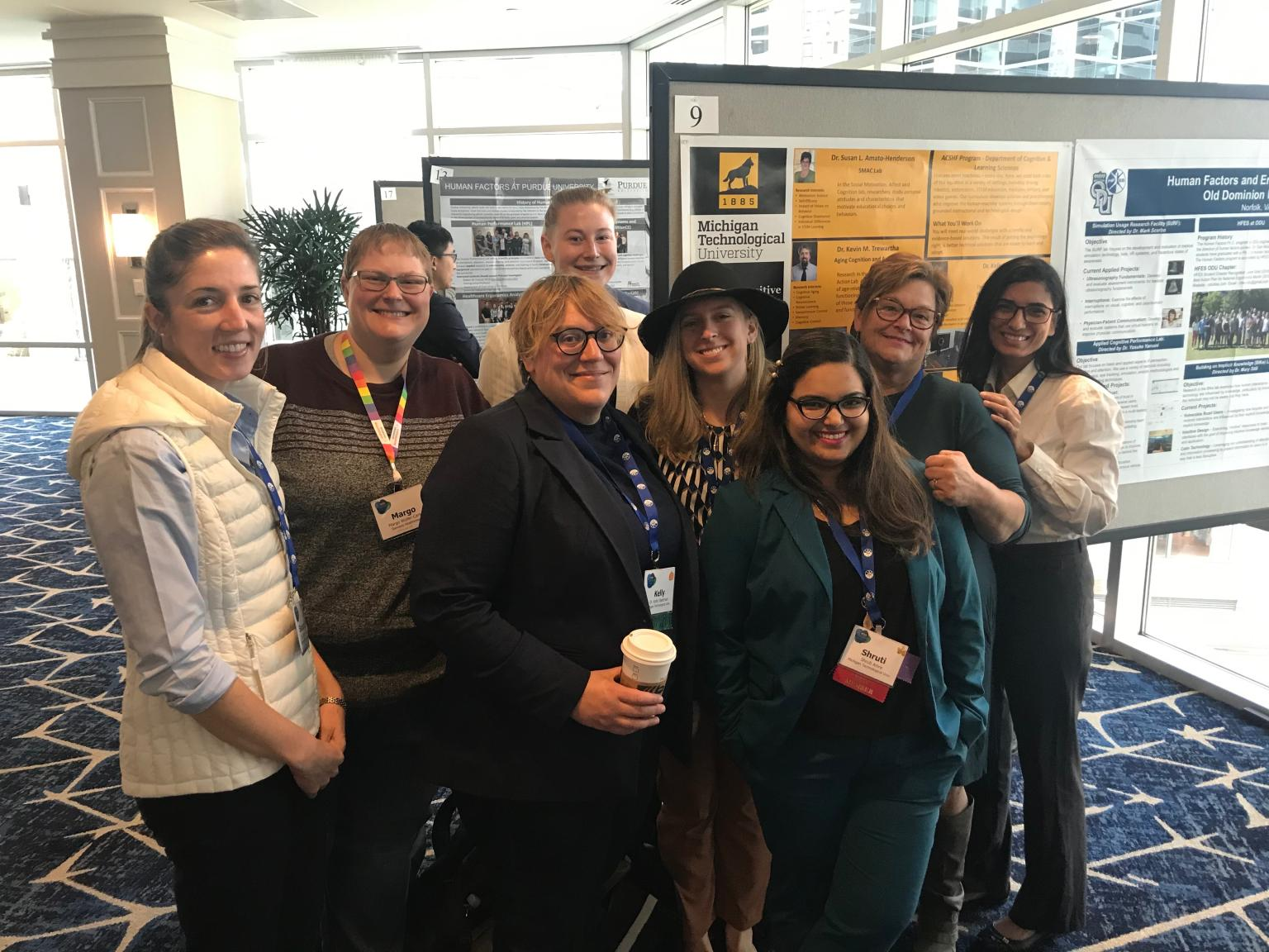 Nine faculty and students at conference