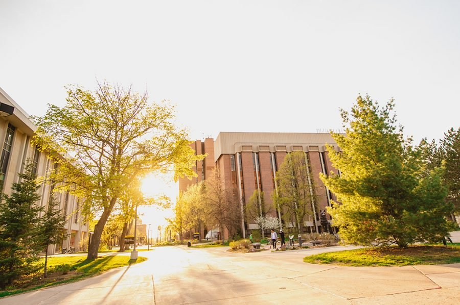 Sun rising between two buildings on Michigan Tech's campus.