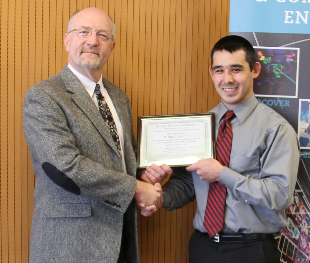 Michael Briseno receives Mi-Light Scholarship award from ECE Chair Dan Fuhrmann