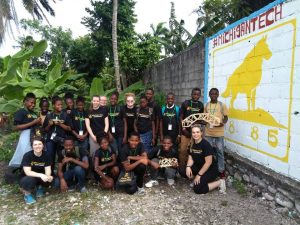Michigan Tech students work with Haitian students on STEM activities at HUT Outreach.