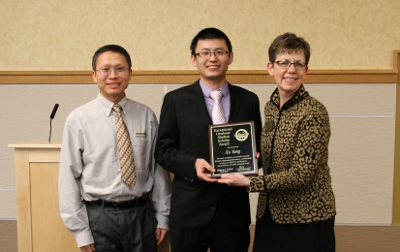 Exceptional Graduate Student Scholar Award to Xu Yang, Department of Civil Engineering, Graduate Research Colloquium 2015 at Michigan Technological University; Presented by Dean of Students Bonnie Gorman and Dr. Zhanping You