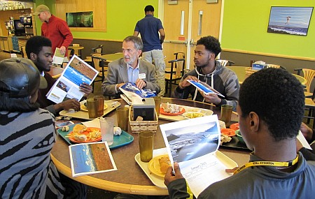 Michigan Tech Dean of Engineering Wayne Pennington has lunch with visiting students.