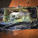 A damaged  Samsung Galaxy Note 7 after its lithium battery caught fire. Photo Credit: Shawn L. Minter, Associated Press