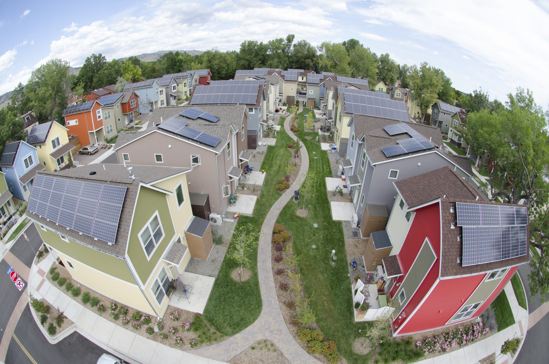 According to the National Renewable Energy Lab (NREL), distributed energy resources like these photovoltaic (PV) systems in a Boulder neighborhood—especially when they are paired with on-site storage—may eventually make large centralized power plants obsolete. Photo Credit: Topher Donahue