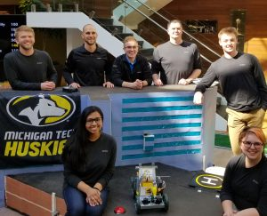 Michigan Tech BME students Emil Johnson, Nicholas Turowski, Melanie Thomas, and Becky Daniels along with mentor Joe Thompson at the 2018 Stryker Engineering Challenge, where they took first place.