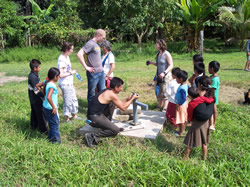 Engineers Without Borders working on a ground pump with local people.