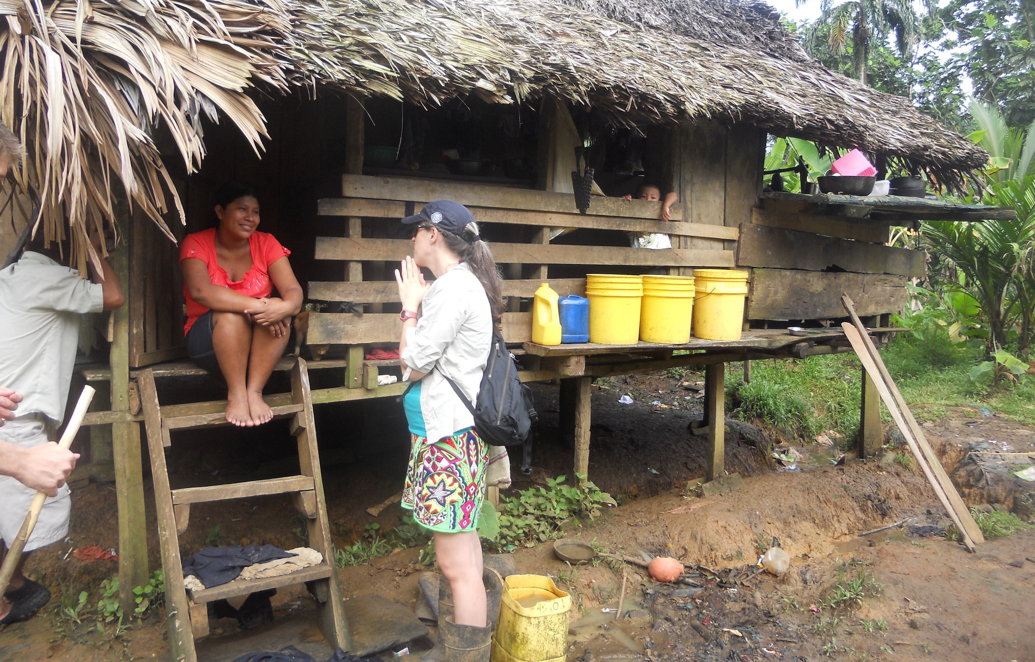 A community woman uses buckets to carry water for her family in Nidori, in the province of Bocas del Toro, Costa Rica
