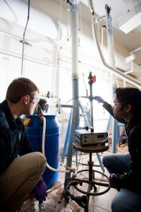 Sam Root and Sriram Valuri at work on the carbon dioxide scrubber
