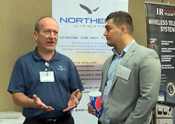 Aerospace Expo 2018 showing participants talking next to posters