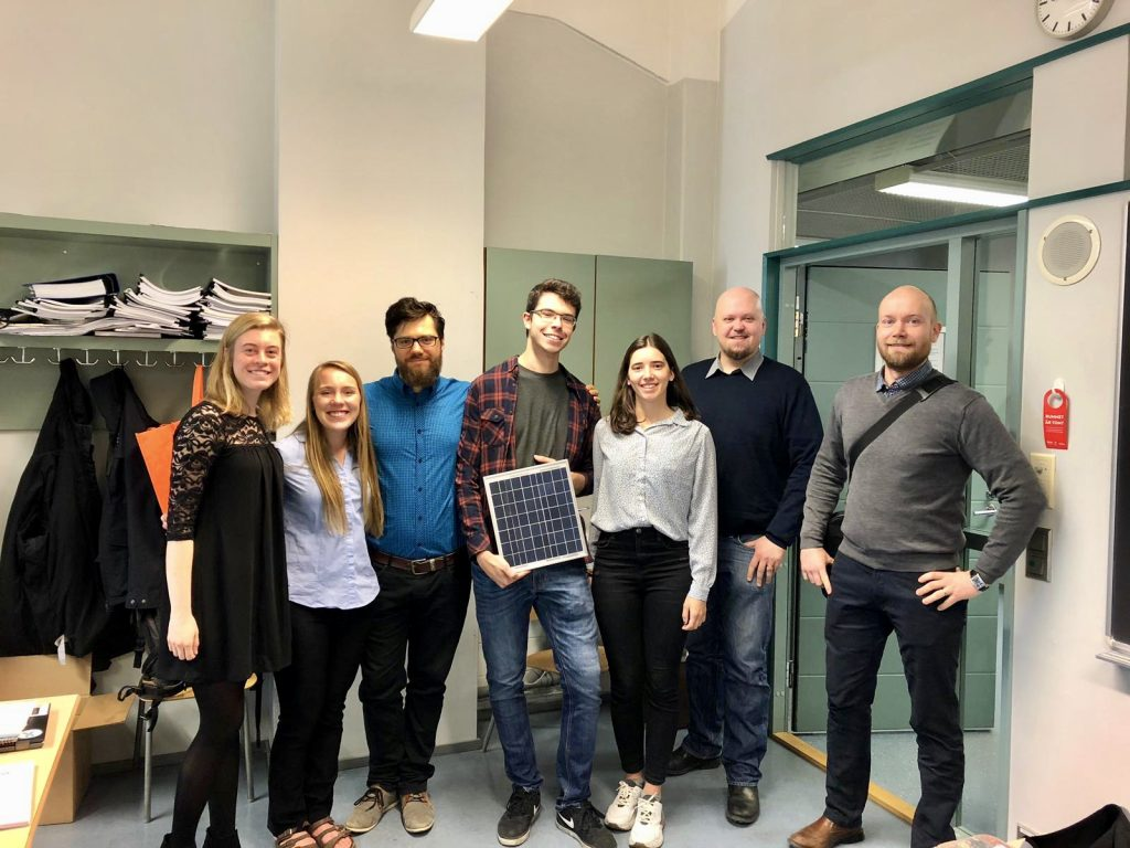 Amber Kauppila and the Floating Solar Panel Park design team at Novia University of Applied Sciences in Vaasa, Finland. One student holds a small solar panel.