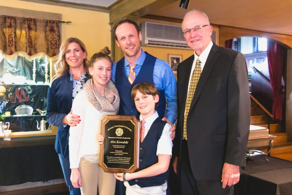 Alex Kowalski, with wife Holly and their two children.